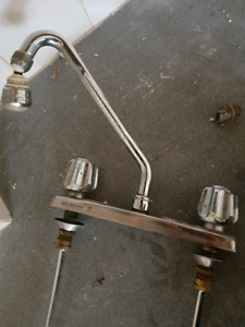 Kitchen faucet and old laundry tub faucet