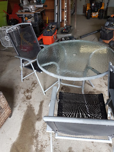 Glass patio set with 4 chairs