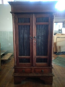 Teak and iron armoire
