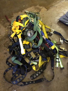 Fall arrest harnesses