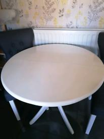 Extending white kitchen table four chair