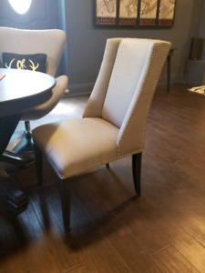 2 Grey Accent wing Chairs.