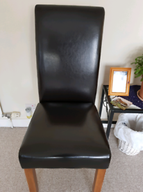 Two Dark Brown Leather Chairs For Sale