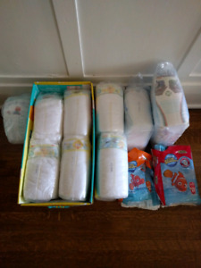 232 Assorted Pampers diapers (size 4, 5 and swim pants)