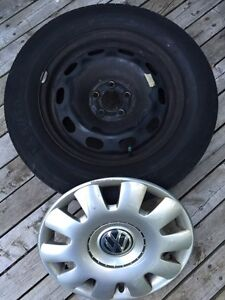 """15"""" steelies with winter tires and VW hub caps"""