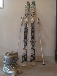 Brand new used once Skis, poles, and boots