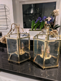 Pair of brass 3 light hanging hall lanterns with glass panes