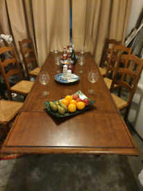 Solid oak 8 to 12 seat table and 6 matching chairs