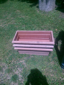 3 large planters that sit on a wide railing London Ontario image 2