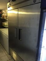 Stand up freezer. Stainless steel, with racks works great