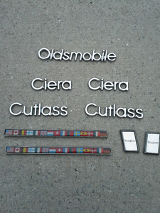 1987 Oldsmobile Cutlass Ciera emblems.