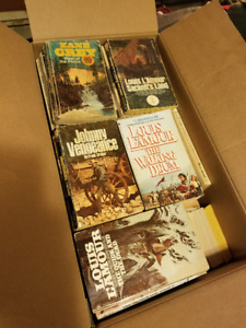 Box full of Louis L'Amour and Zane Grey novels