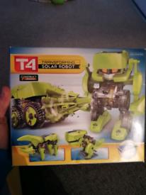 Transforming solar robot toy