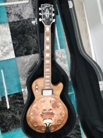 Custom copper caster resonator guitar