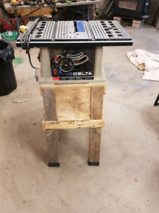 "10"" delta table saw with stand."