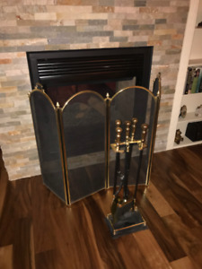 Solid Brass, cast iron/black metal fire guard and fire tools.