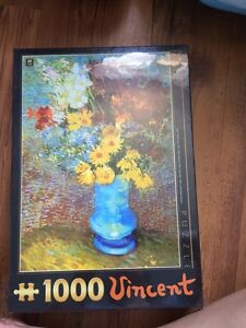 """Brand new """"Flowers in Blue Vase"""" 1000 piece puzzle."""