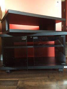 TV SWIVEL STAND WITH GLASS DOOR ON WHEEL (Excellent Condition)