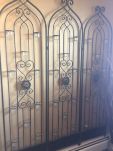 Wrought iron room divider/screen with votive candles