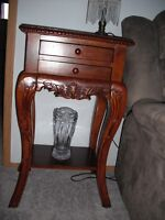 Ashley carved wood curio cabinets and table