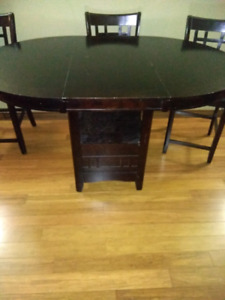 Dark wood bar height table and chairs