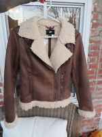 Brown leather jacket with wool trim