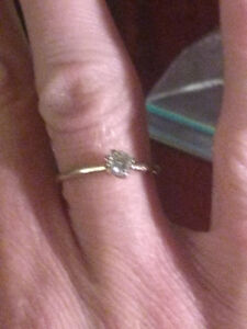 Diamond engagement ring or promise ring.