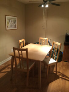 Dining table, 4 chairs and matching cabinet