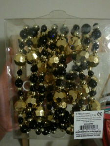 Black and Gold Decor/Garland/String Beads. 5.00 EACH Box.