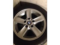 Set of 4 bmw alloys each with a new tyre on it