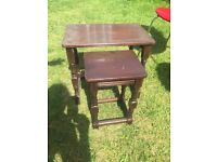2 small wooden tables