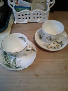 Two bone china tea cups. One for $15.00 two for $25.00. Pics.