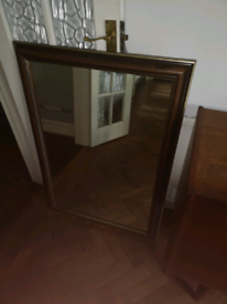 Large mirror in wooden frame
