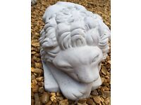 Lying down lions and proud standing lions concrete garden ornaments