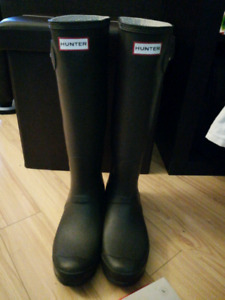 Pair of Hunter boots almost new condition and Hunter socks