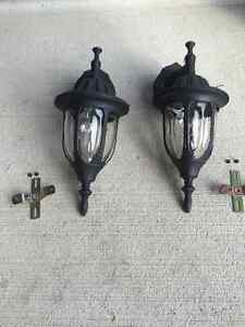 Two outdoor lights with brackets