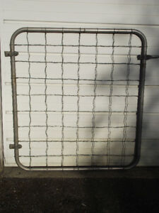 Braided wire fence gate.