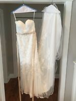 Stella York lace and tulle ivory wedding gown