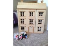 Dolls house with 100 accessories and family