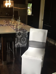 White chair covers, black sashes, table runners