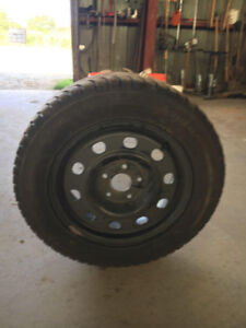 Almost new 17 inch winter tires and rims