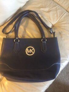 Brand new Michael Kors navy blue purse. REDUCED