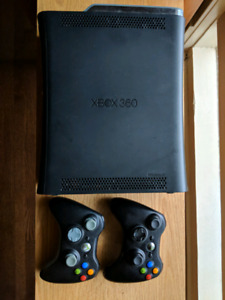 XBOX 360 with controllers, hard drive, and wifi adapter