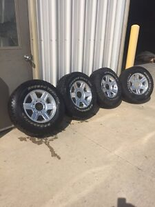 4 tires and rims of a 2500 Dodge Ram