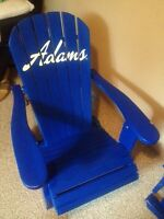 Two wooden and foldable adirondack chairs