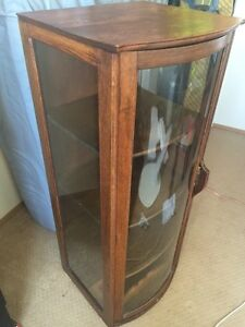 Vintage locking display cabinet with curved glass