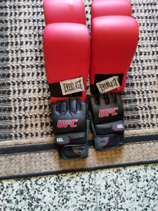 2 pairs of large boxing gloves and 1 pair of ufc large gloves