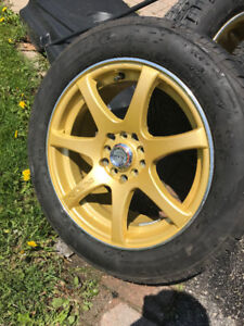 16 inch RTX gold rims with all season tires almost brand new