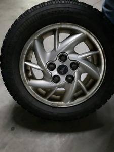 4 Good Year Nordic snow tires and rims