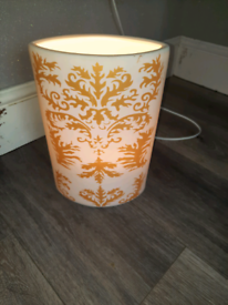 White and gold table lamp.